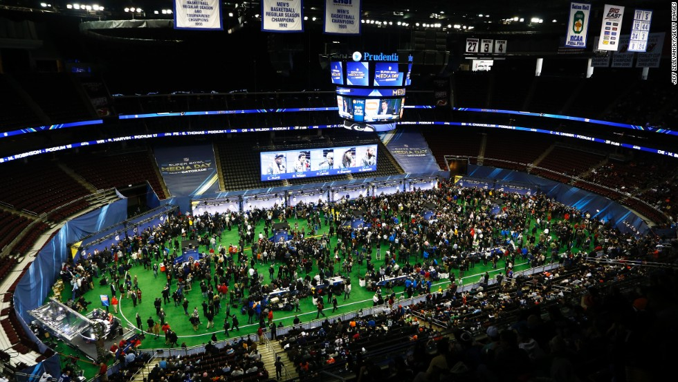 People attend Super Bowl XLVIII media day at the Prudential Center in Newark, New Jersey, on Tuesday, January 28.