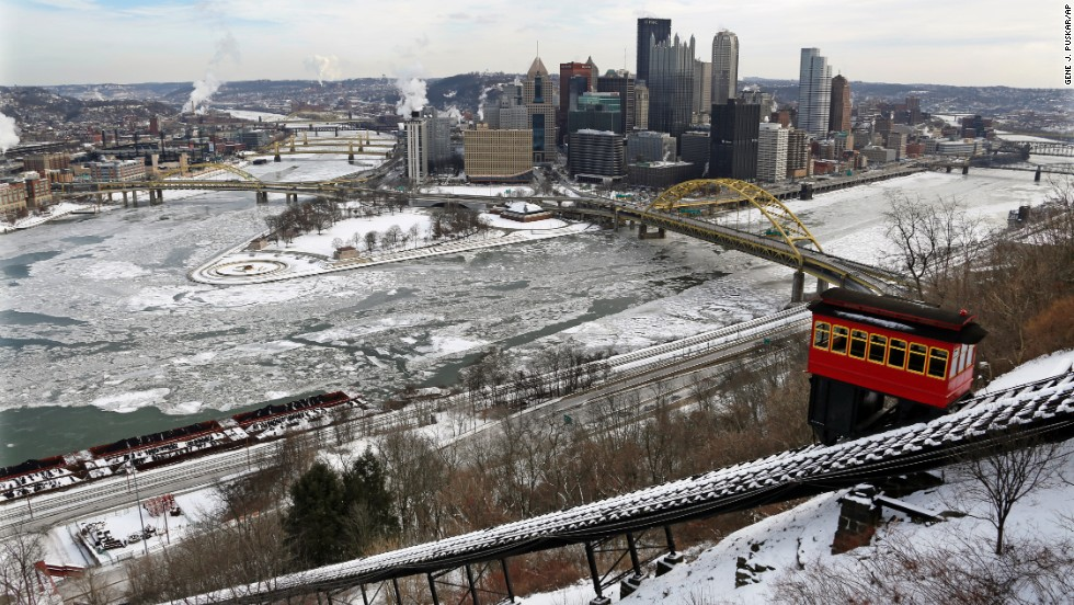 The Duquesne Incline climbs Mount Washington across the frozen Ohio, Allegheny and Monongahela rivers in downtown Pittsburgh on January 28.