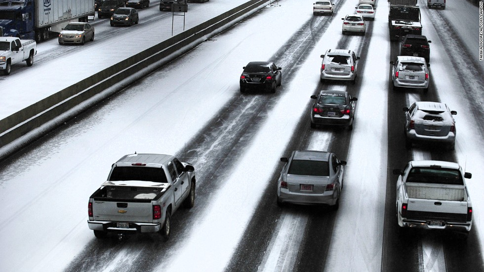 Traffic travels along the highway near downtown Birmingham on January 28.