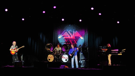 "'80s supergroup Asia had one of their biggest hits, ""Heat of the Moment,"" in 1982 but that hasn't stopped them for continuing to rock out. Guitarist Steve Howe retired in 2013."