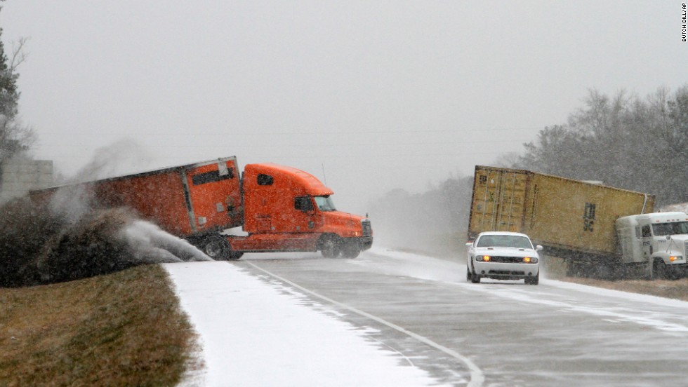 A semi slides off the road as the driver tries to avoid another wrecked truck as snow begins to accumulate on Interstate 65 in Clanton, Alabama, on January 28. Clanton lies between the capital, Montgomery, and the state's biggest city, Birmingham.