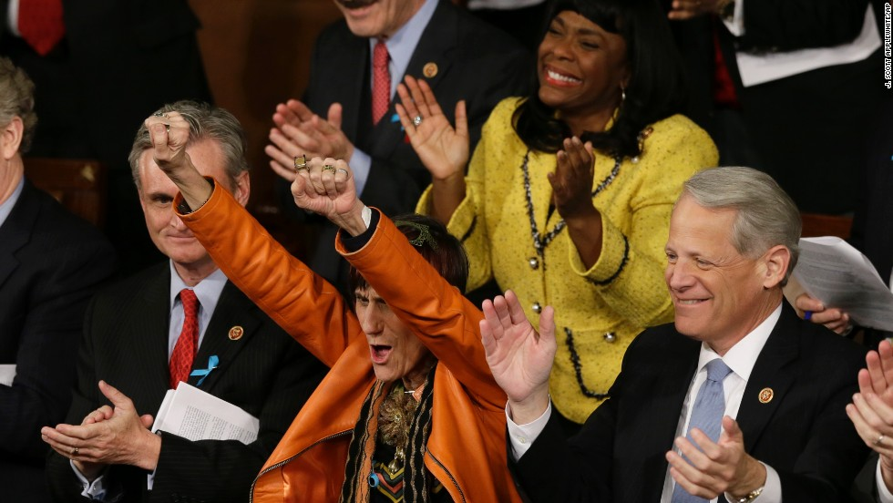 Rep. Rosa DeLauro, D-Connecticut, center, and Rep. Terri Sewell, D-Alabama, cheer during Obama's speech.