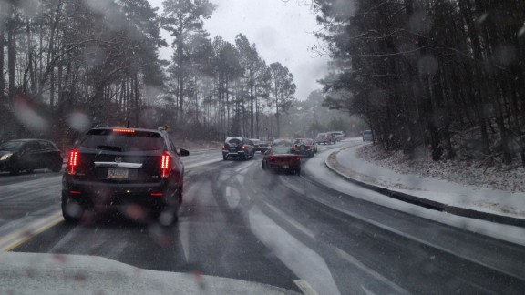 """<a href=""""http://ireport.cnn.com/docs/DOC-1078920"""">Ian Walters</a> says it took about an hour to make the five-mile drive to his Roswell, Georgia, home on Tuesday afternoon. He says the car he was riding in hit a patch of ice on the way up this hill and got stuck for about 10 minutes. Walters was one of the lucky ones, though -- many Atlanta residents reported commutes that took several hours longer than usual."""