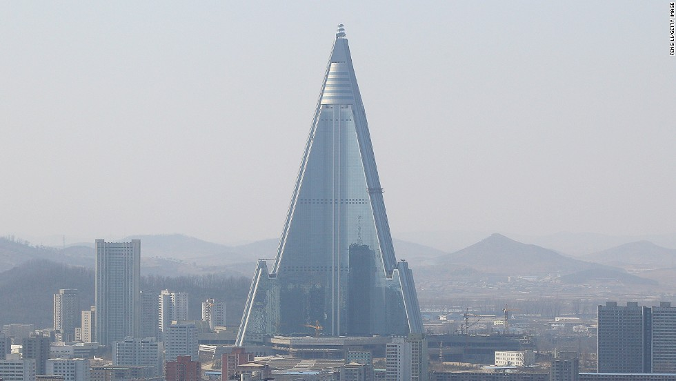 "<em>Ryugyong Hotel</em><br /><br />North Korea's tallest structure rises menacingly 330 meters over Pyongyang, and has been in construction for over two decades. Works stopped completely when cash flow was severed after the collapse of Soviet Union in 1992, but resumed in 2008. The pyramidal building, nicknamed ""The Hotel of Doom"", is set to be finally finished, or partially open in 2014."