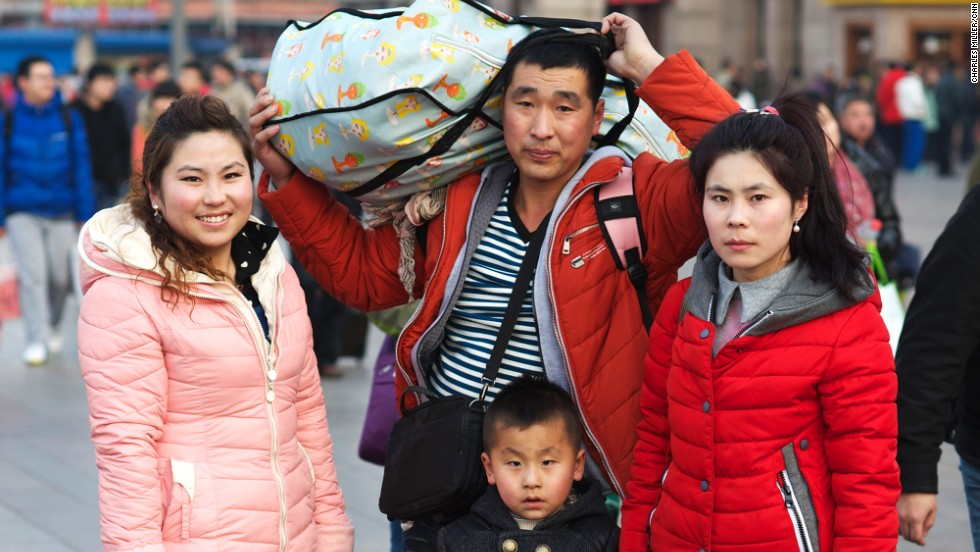 Li Hangyu (center) with his five-year-old son, his wife and sister. For the last four years they have run a small business in Zhangjiakou, Hebei province.