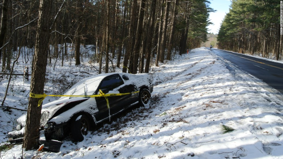 Caution tape is wrapped around a car that crashed into a tree after the driver lost control in Snellville, Georgia, on January 29.