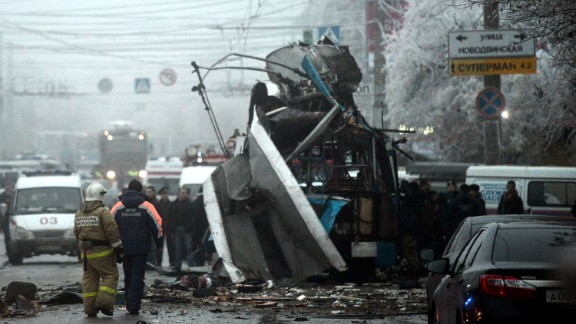 Russian firefighters and security personnel inspect the destroyed trolleybus in Volgograd on December 30, 2013.