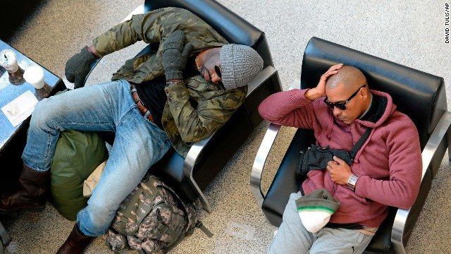 Travelers wait out flight delays at Hartsfield-Jackson International Airport in Atlanta on Thursday, January 30.