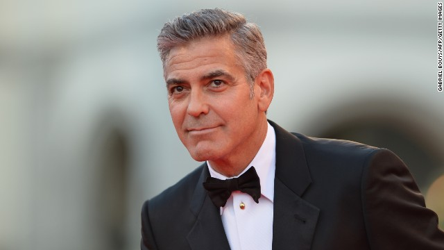 US actor George Clooney arrives for the opening ceremony of the 70th Venice Film Festival and the screening of the movie 'Gravity' presented out of competition, on August 28, 2013 at Venice Lido. The Venice film festival kicks off today with the arrival of movie stars on water t
