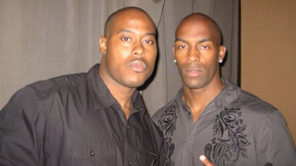 Ronney Jenkins, left, with his cousin, Lorenzo Booker.