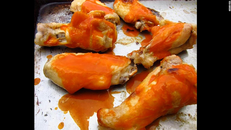 "Most buffalo chicken wings are deep-fried and loaded with fat and calories. <a href=""http://snack-girl.com/snack/healthy-buffalo-chicken-wings-recipe/"" target=""_blank"">This fitter option</a> calls for boiling and baking the wings."