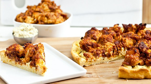 Vegans at your game party? Try buffalo-cauliflower wing pizza with tofu-blue cheese spread. Roasting cauliflower makes it crunchy and chewy, not rubbery.