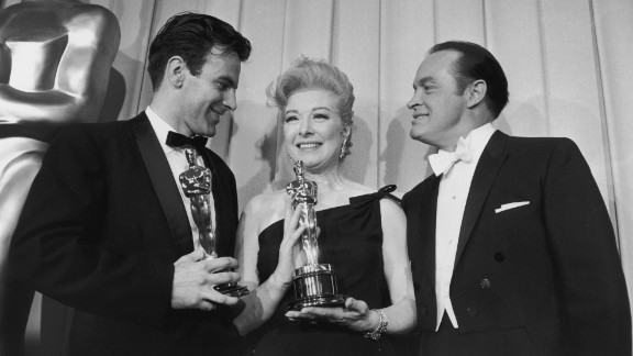 """Schell is seen backstage at the 1961 Academy Awards with actress Greer Garson and host Bob Hope. Schell was awarded Best Actor for his role in """"Judgment at Nuremberg."""" Garson accepted the Best Actress award for Sophia Loren."""