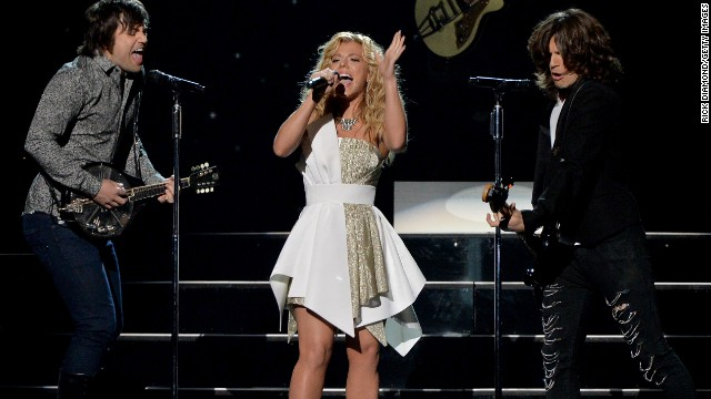 The Band Perry -- siblings, from left, Neil, Kimberly and Reid Perry -- have also offered to pay hotel expenses for family members staying near where the fire's survivors are being treated.