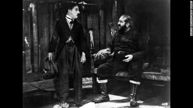 "In 1925's ""The Gold Rush"" Chaplin's character ventures to Alaska on a quest for gold. Mack Swain also  appared in the film wrtiten, produced and directed by Chaplin."
