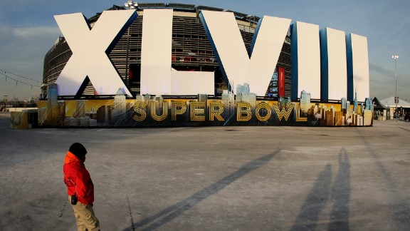 A security guard stands in front of MetLife Stadium Saturday, February 1, in East Rutherford, New Jersey, the site of Sunday's NFL championship game between the Denver Broncos and the Seattle Seahawks.