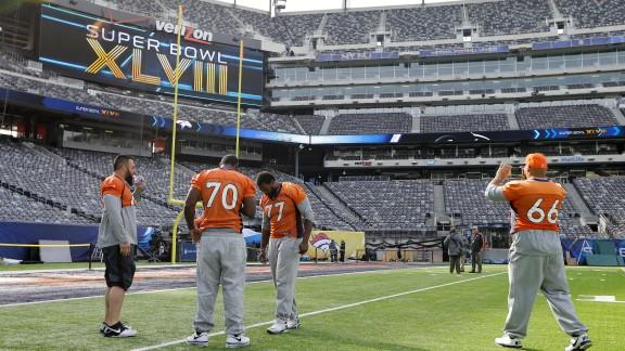 Denver Broncos players Louis Vasquez, left, Vinston Painter, Winston Justice, and Manny Ramirez  look around MetLife Stadium before the team's walk-through on February 1.