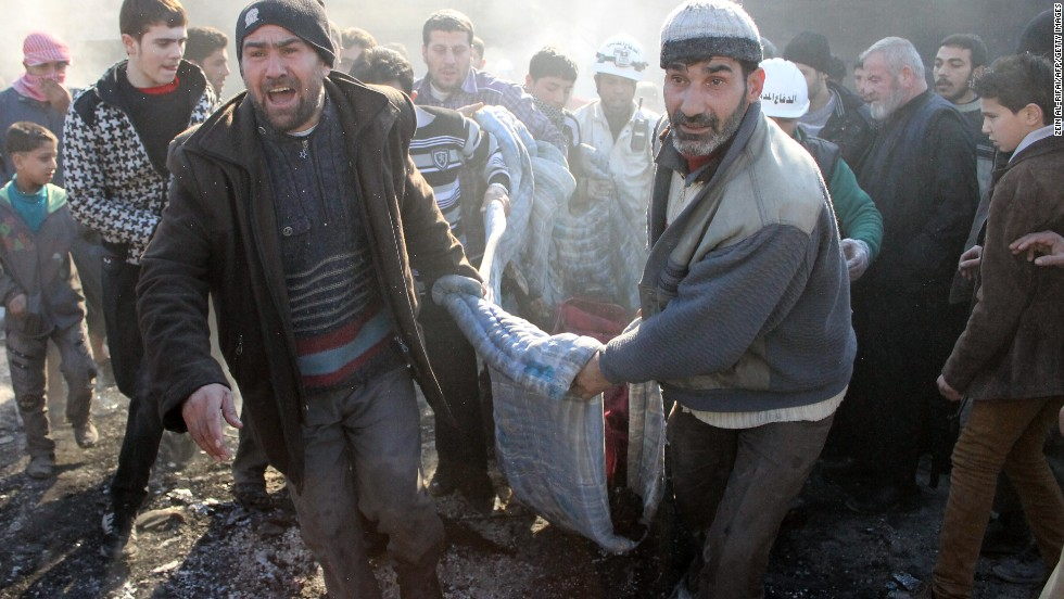 Syrians carry a dead body following an airstrike on February 1.