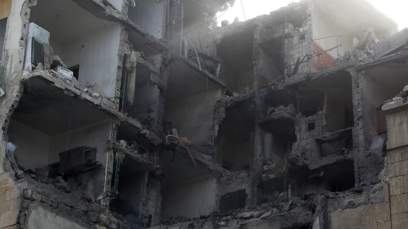 A damaged building is seen in the northern Syrian city of Aleppo on February 2, 2014 following reported air strikes by government forces.