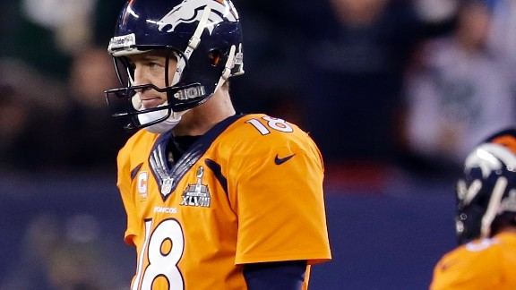 Manning (18) cuts a dejected figure after he walks off the field after being intercepted.