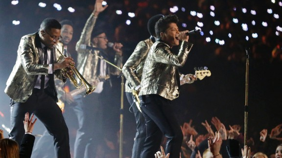 """After a children's choir opened the show, Mars and his band perform the smash hit """"Locked Out of Heaven."""""""