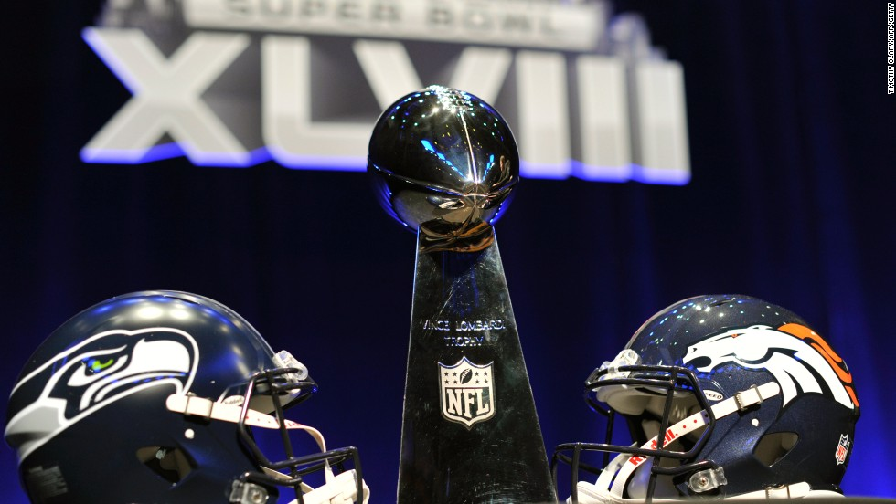 The Helmets Of Competing Super Bowl Teams Seattle And Denver Flank Iconic Vince Lombardi