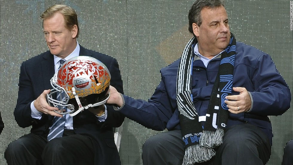 New Jersey Governor Chris Christie takes a welcome break from recent political controversies to share a moment with NFL Commissioner Roger Goodell in the build up to Super Bowl XLVII.
