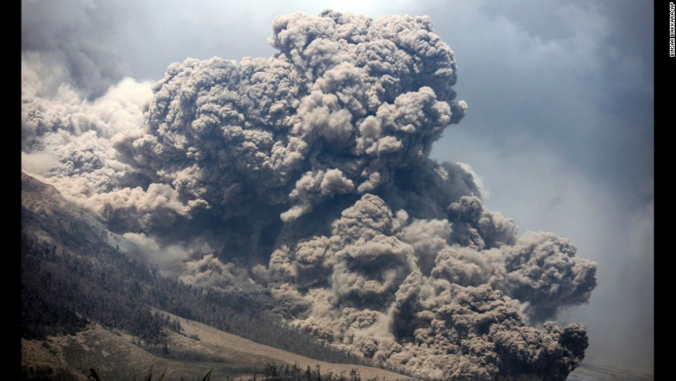 Mount Sinabung releases ash into the sky during an eruption as seen from Payung village in North Sumatra, Indonesia, on Monday, February 3. Sinabung erupted in 2010 and has been emitting gas since September.