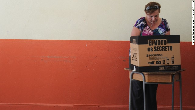 A woman casts her vote in San Jose during the presidential election, on February 2, 2014. Costa Ricans choose a new president Sunday from a field of four candidates, none of whom have a clear lead in the polls and with nearly a third of voters undecided.
