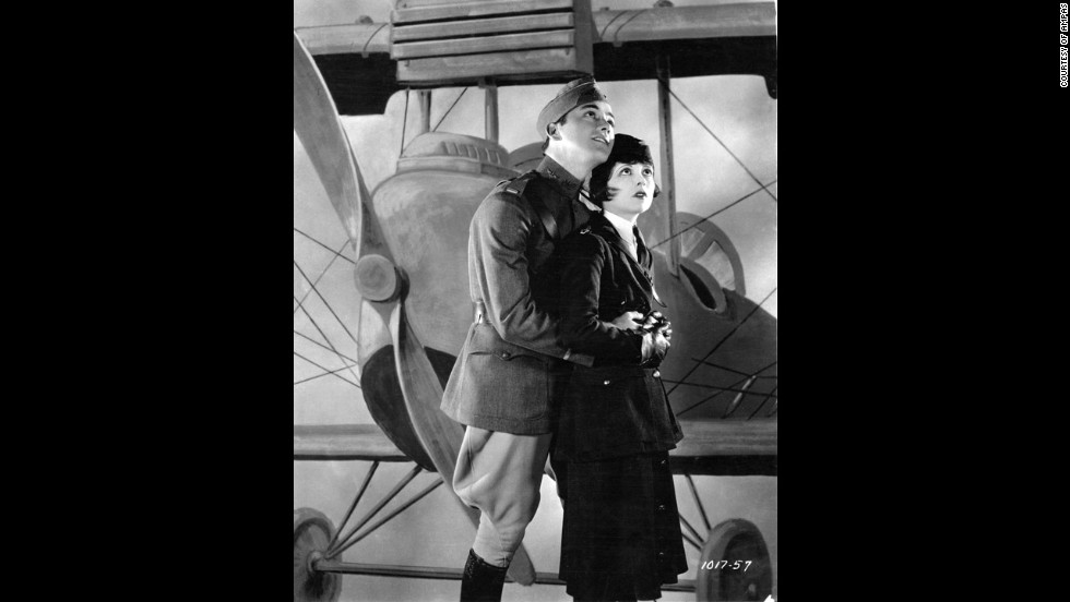 "The first Academy Awards were given out at a dinner on May 16, 1929. The best picture winner was 1927's ""Wings,"" a film about World War I pilots starring Clara Bow, right, Charles ""Buddy"" Rogers, left,  Richard Arlen and Gary Cooper. Even today, the silent film's aerial sequences stand out as some of the most exciting ever filmed. Another film, ""Sunrise,"" was given an Oscar as most ""unique and artistic production,"" an honor that was eliminated the next year. The academy didn't begin using a calendar year for awards until movies made in 1934 (with ceremonies held in 1935)."