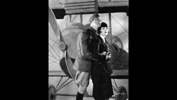 """Wings"" (1929): The first Academy Awards were given out at a dinner on May 16, 1929. The best picture winner was 1927's ""Wings,"" a film about World War I pilots starring Clara Bow, right, Charles ""Buddy"" Rogers, left,  Richard Arlen and Gary Cooper. Even today, the silent film's aerial sequences stand out as some of the most exciting ever filmed. Another film, ""Sunrise,"" was given an Oscar as most ""unique and artistic production,"" an honor that was eliminated the next year. The academy didn't begin using a calendar year for awards until movies made in 1934 (with ceremonies held in 1935). While the Academy awards the Oscars for work from the previous year, we are listing these with the years of the actual ceremony to avoid confusion."