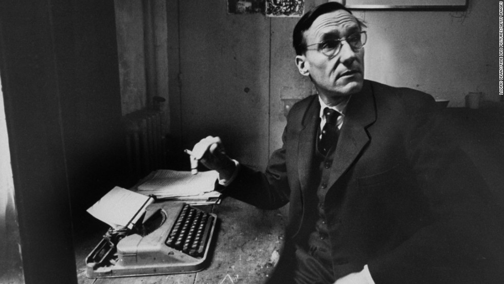 Author William S. Burroughs sits with a typewriter in 1959.