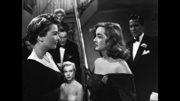"""""""All About Eve"""" (1951): Director Joseph L. Mankiewicz's screenplay about an aging actress (Bette Davis, right) battling a scheming newcomer (Anne Baxter) remains one of the most quotable movies ever almost 65 years after its release. """"All About Eve"""" held the record for a movie with the most Oscar nominations (14) until """"Titanic"""" tied it in 1997. A young Marilyn Monroe, center, also attracted attention in an early role. As Margo Channing (Davis' character) would say, """"Fasten your seat belts, it's going to be bumpy night!"""""""