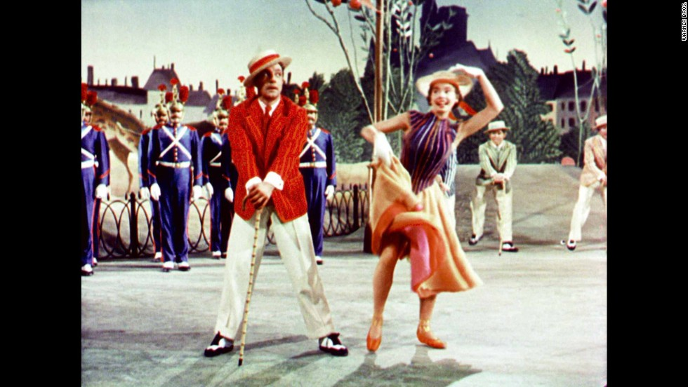 "In 1952 ""An American in Paris"" starring Gene Kelly and Leslie Caron overtakes ""A Streetcar Named Desire"" and becomes only the second color film to win a best picture Oscar. ""Gone with the Wind"" was the first."