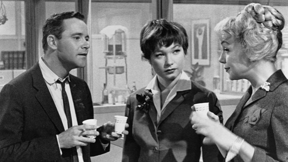 """""""The Apartment"""" (1961): Long before """"Mad Men,"""" Billy Wilder's """"The Apartment"""" skewered corporate life of the early 1960s. Up-and-comer Jack Lemmon stays busy loaning his apartment key to company men who need a place to cheat on their wives. He falls for Shirley MacLaine, center, who is having an affair with one of the bosses (""""My Three Sons' """" Fred MacMurray in an unsympathetic role)."""