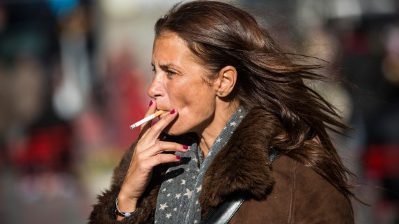 A woman smokes a cigarette on January 17 in Times Square in New York.