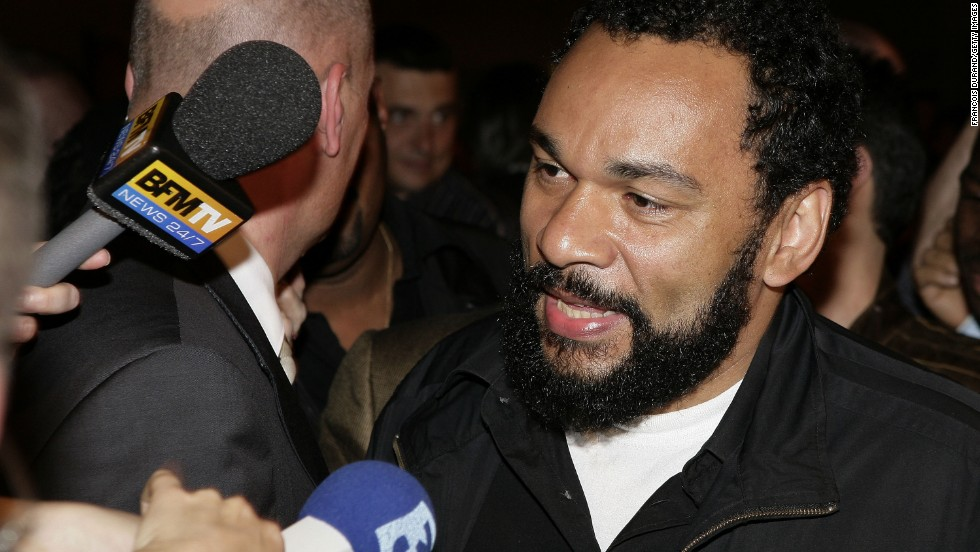 "Controversial French comedian <a href=""http://cnn.com/2014/02/03/world/europe/uk-french-comic-banned/index.html"" target=""_blank"">Dieudonné M'bala M'bala</a> was banned from British soil in February 2014 after making an anti-Semitic gesture.  He said the gesture was anti-establishment."
