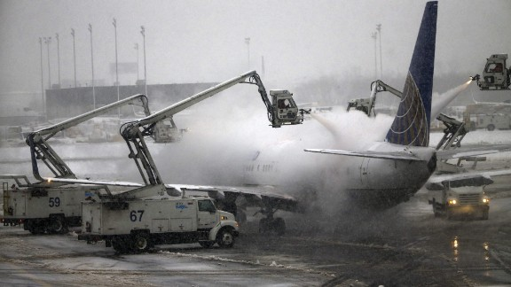 A United Airlines jet is de-iced before taking off from New Jersey's Newark Liberty International Airport on Monday, February 3.