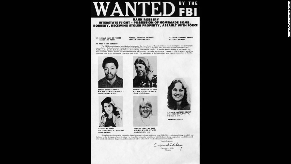 Four days after the robbery, the FBI released this wanted poster, featuring Hearst, far right, as a material witness, among other SLA members suspected of taking part in the heist. SLA leader Donald DeFreeze is at top left.