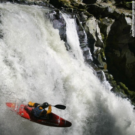 A boat, a paddle and one helluva brave kayaker.