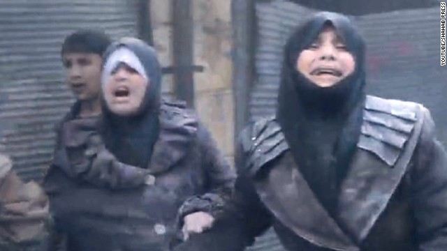 Women wail in agony after an alleged barrel bomb dropped by Syrian forces lands in Aleppo.