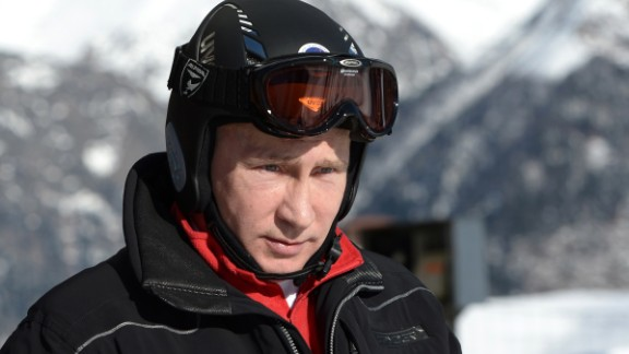 A picture taken on January 3, 2014, shows Russia's President Vladimir Putin visiting the mountain Laura Cross Country and Biathlon Centre near the Black Sea resort of Sochi.