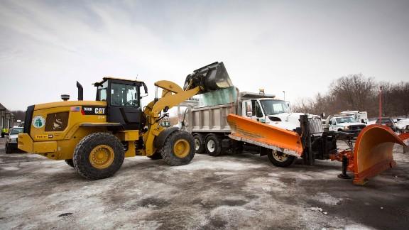 Road salt gets loaded onto a snowplow truck in Glen Ellyn, Illinois, on February 4.