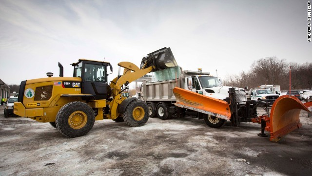 Road salt is loaded into a snow plow truck in Glen Ellyn, Illinois, on Tuesday, February 4.