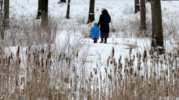 A woman and child take a walk at the North Chagrin Reservation in Willoughby Hills, Ohio, on February 4.