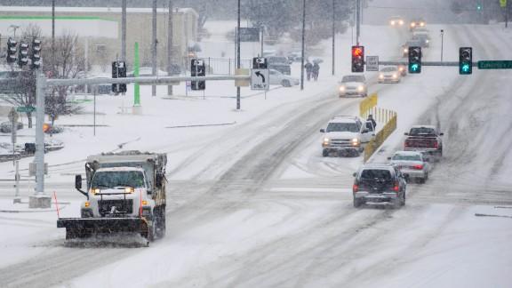 A salt truck clears a road in Columbia, Missouri, on February 4.