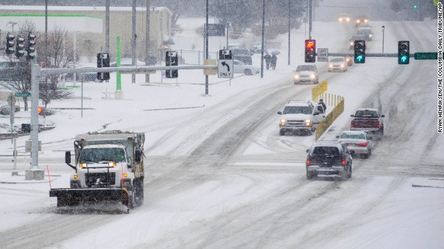Brutal winter has left some cities struggling to get stockpiles of salt to hard-hit areas. A salt truck clears road in Columbia, Missouri, Feb. 4.
