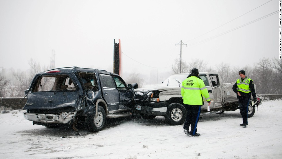 Law enforcement officials evaluate the scene of a crash on Interstate 29 in St. Joseph, Missouri, on Tuesday, February 4.