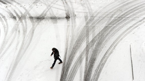 A person crosses a snowy parking garage in Owensboro, Kentucky, on February 4.