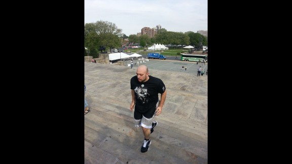 """To celebrate his weight loss, Colao re-created a scene from the movie """"Rocky"""" by running up the stairs at the Philadelphia Museum of Art."""